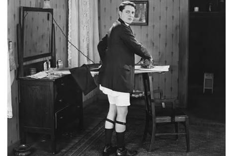 man ironing